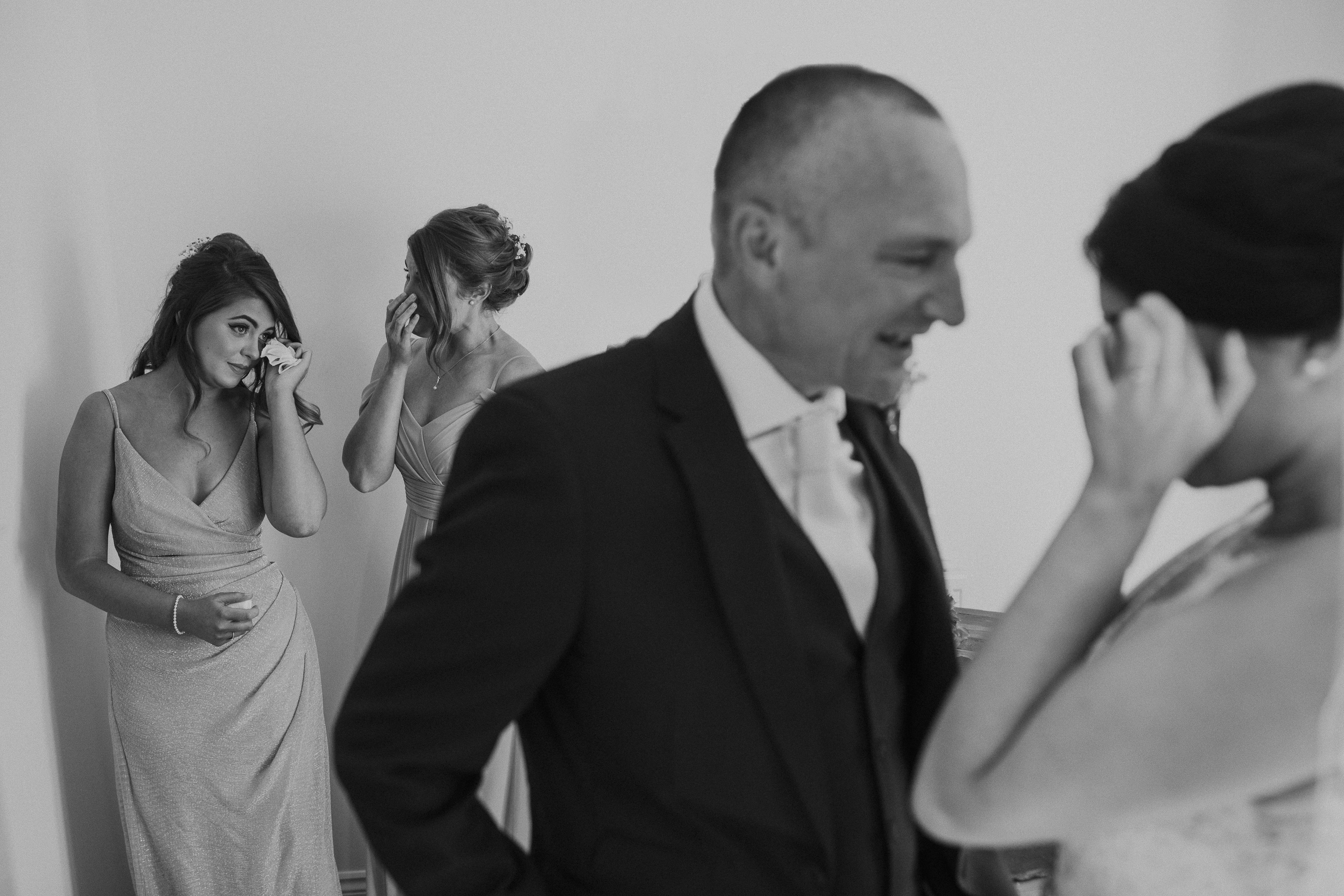 Emotional fathers first look at brides dress