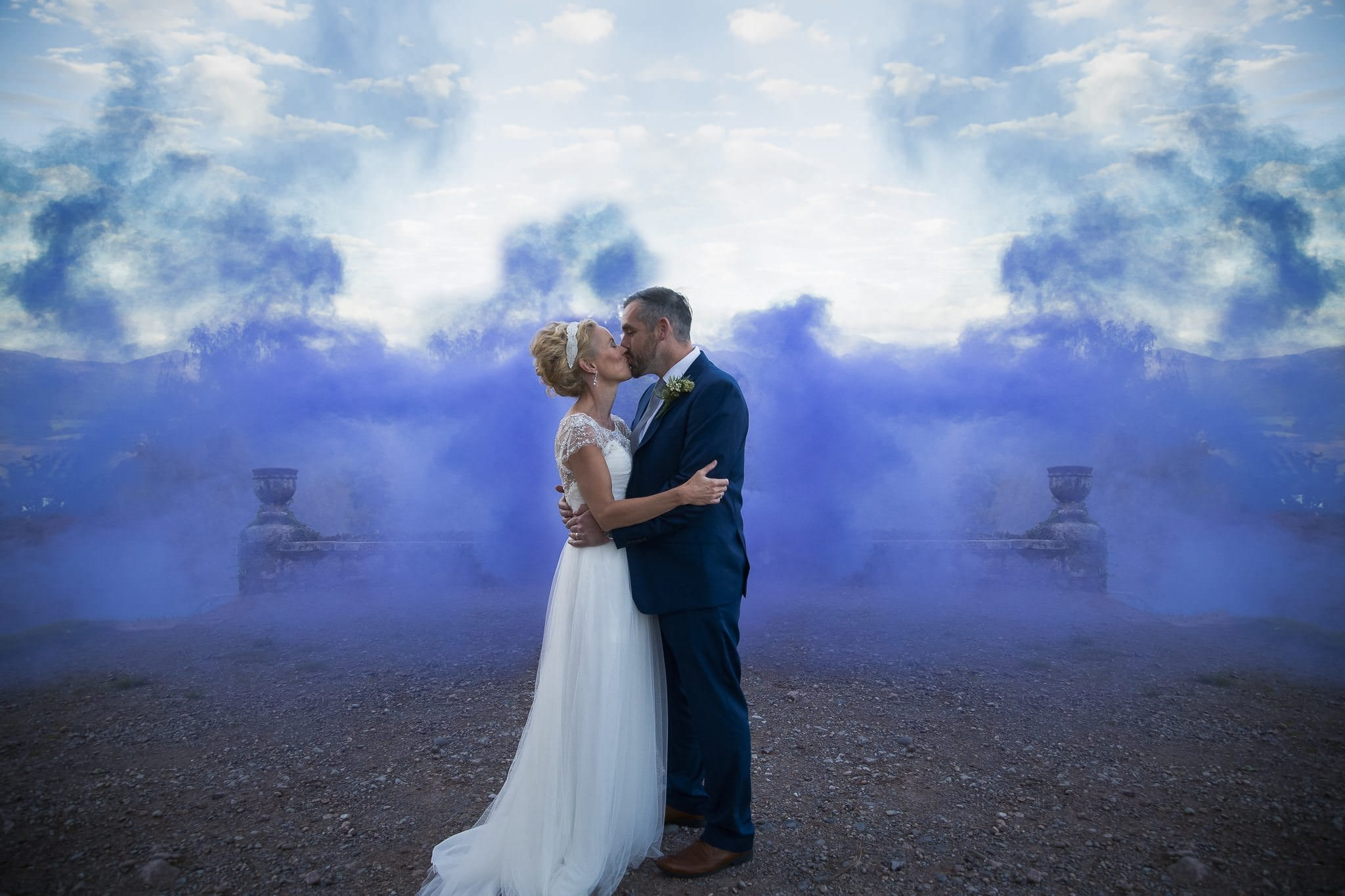 Wedding photograph with smoke bombs as background at Muncaster castle