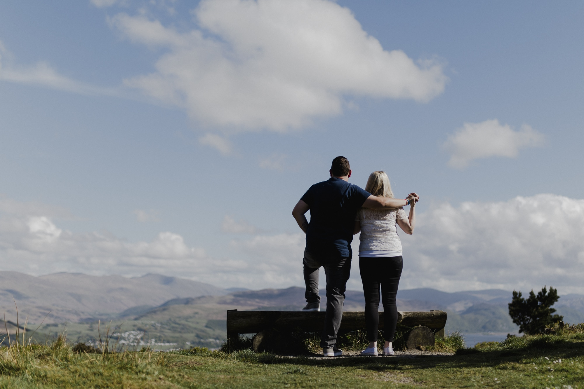 Couple standing on fell top in lake district couple portrait session