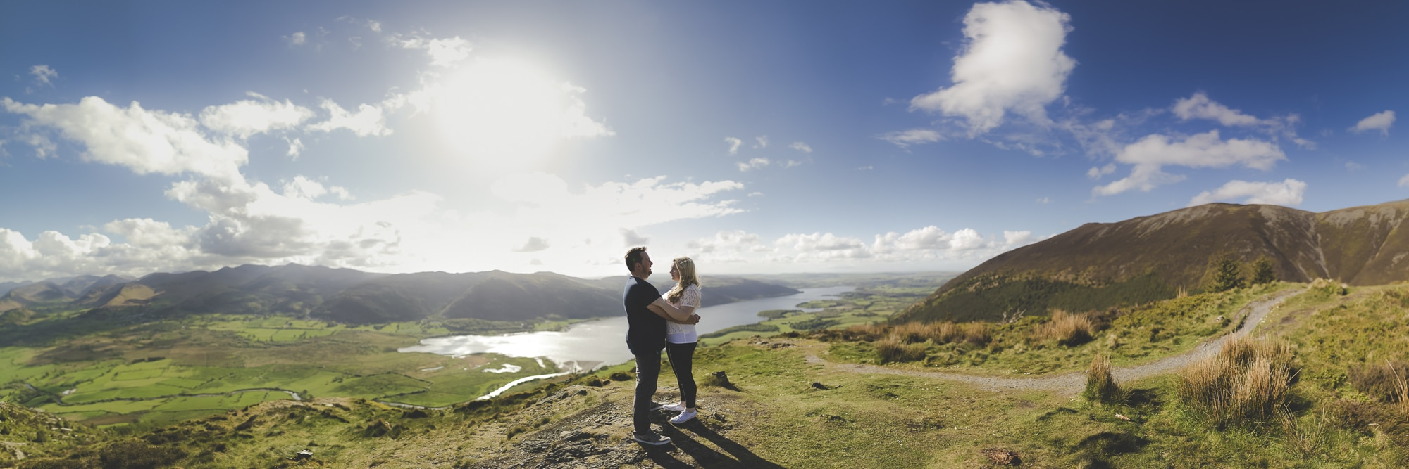 Amazing panorama of couple ontop of the lake district dodds wood