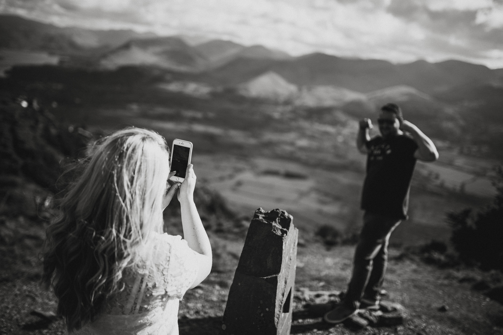 couple taking snapchat selfies ontop of lake district fell dodds wood