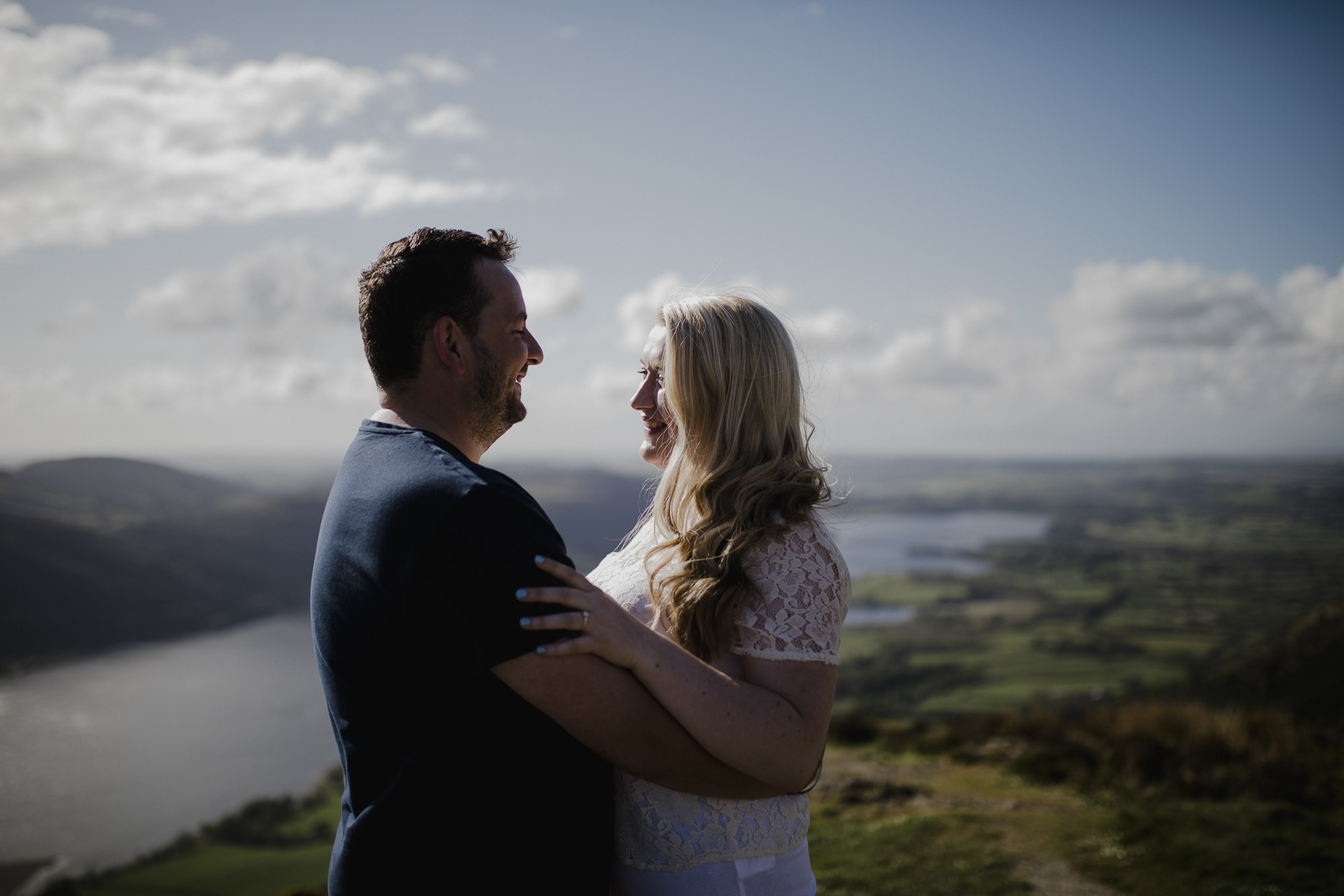 couple hugging ontop of fell in lake district