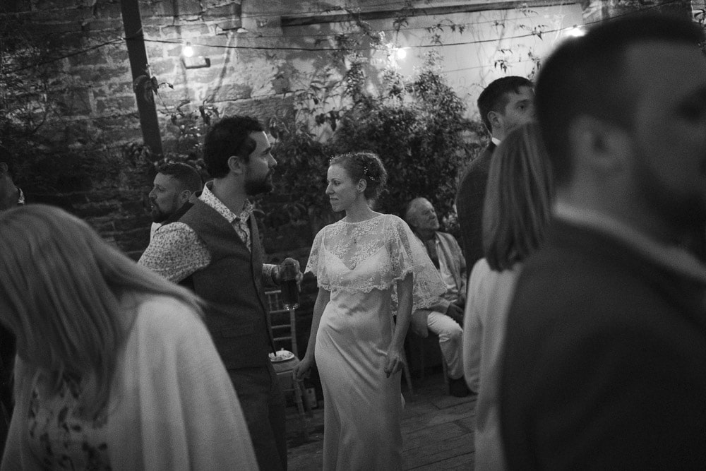 Bride and groom dancing with Kirklinton Hall full of friends and family at a Cumbria wedding