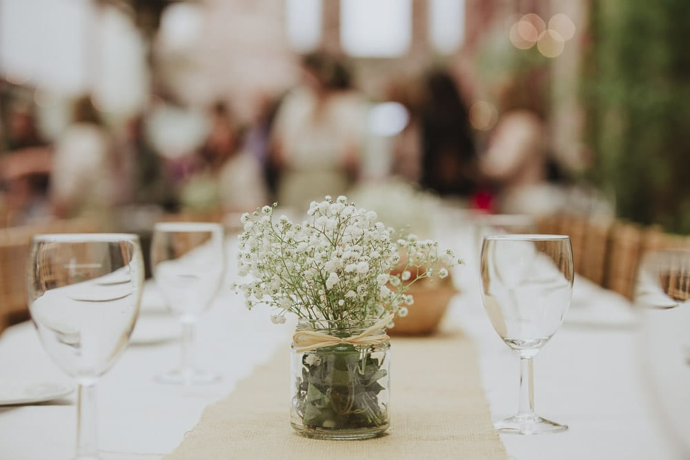 Flowers on the tables of a cumbria wedding