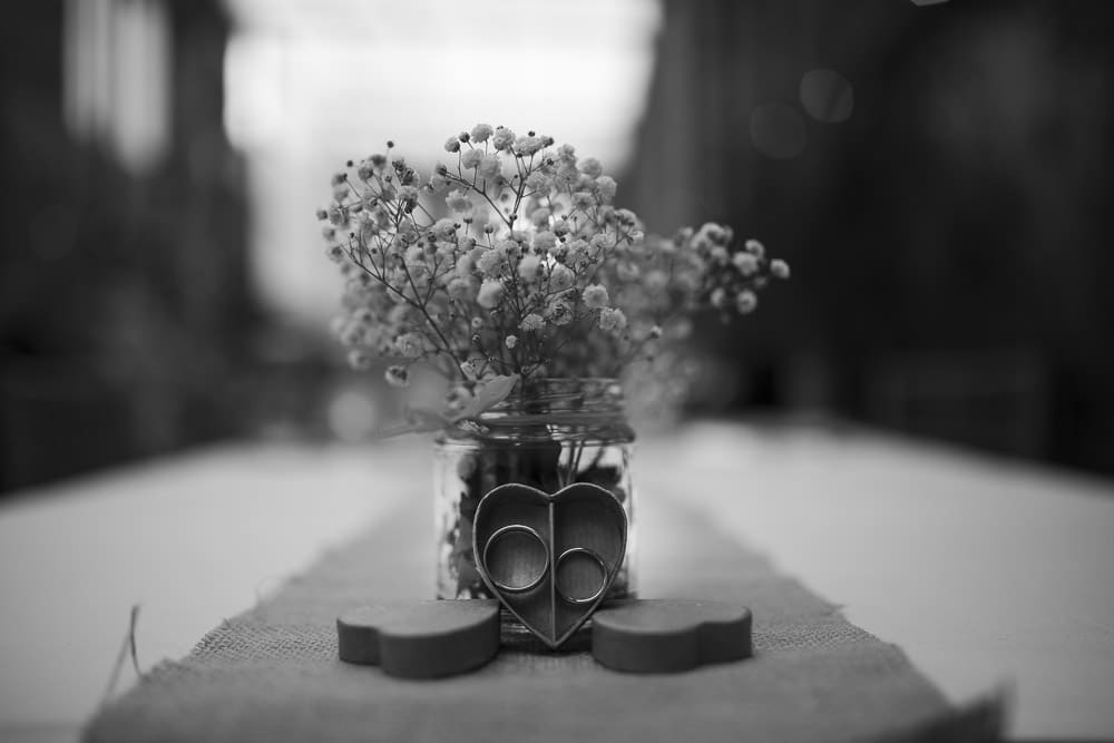 Wedding rings in a heart shaped box bohemian cumbrian wedding at Kirklinton hall