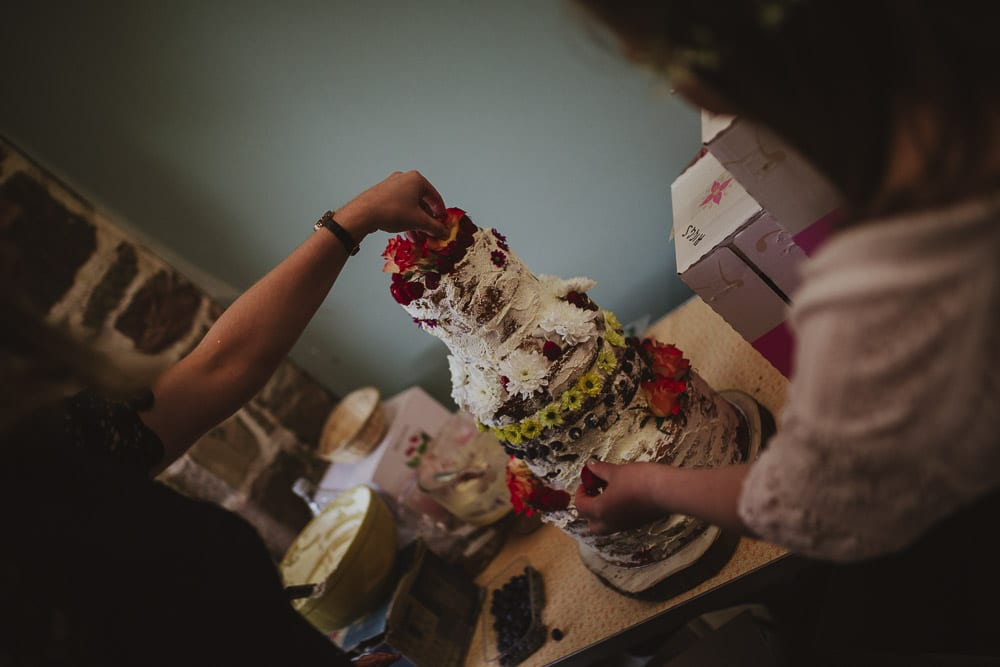 making the wedding cake for Kirklinton Hall Cumbria Wedding Photography