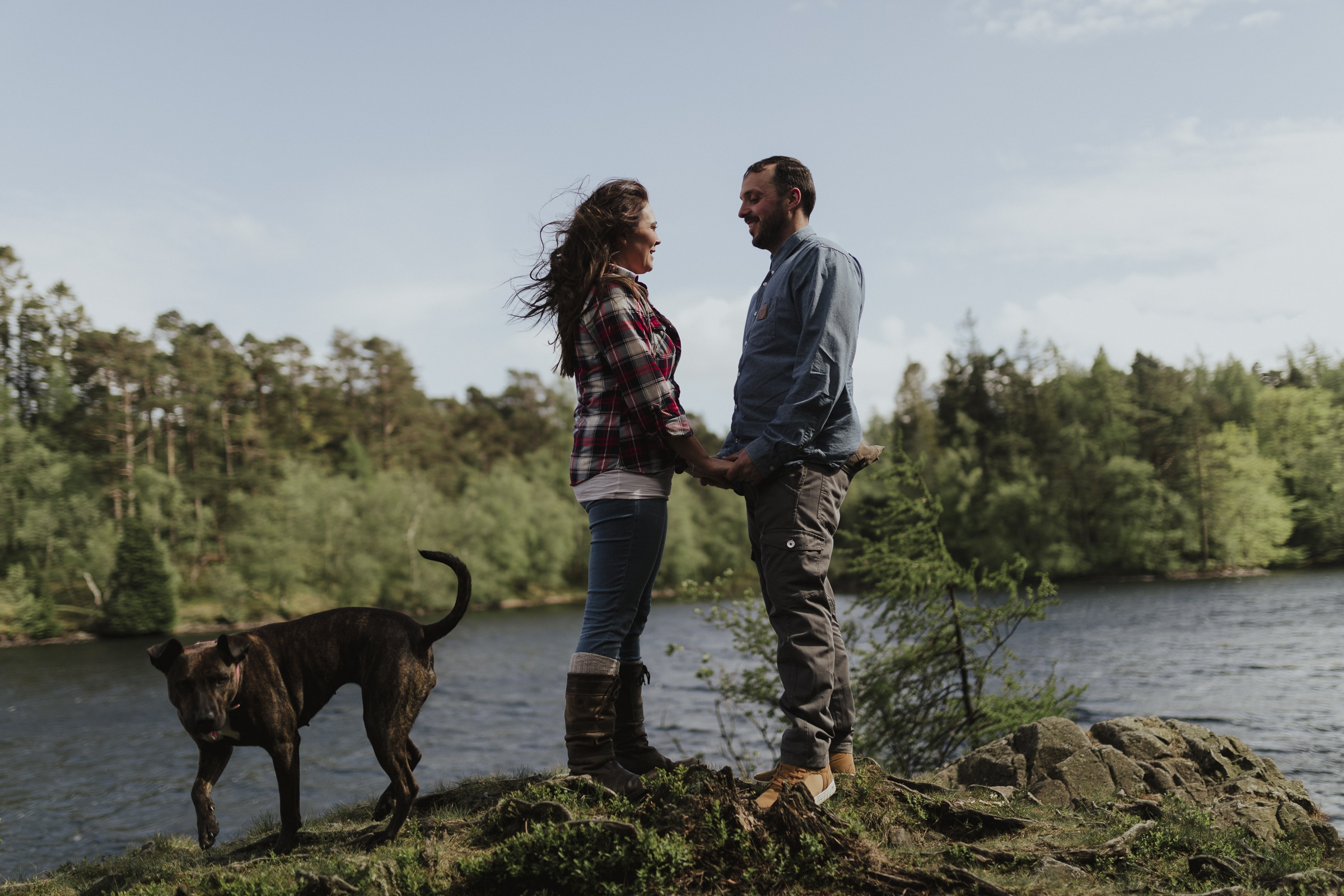 Couples portrait session on tarn hows in the lake district with couple holding hands