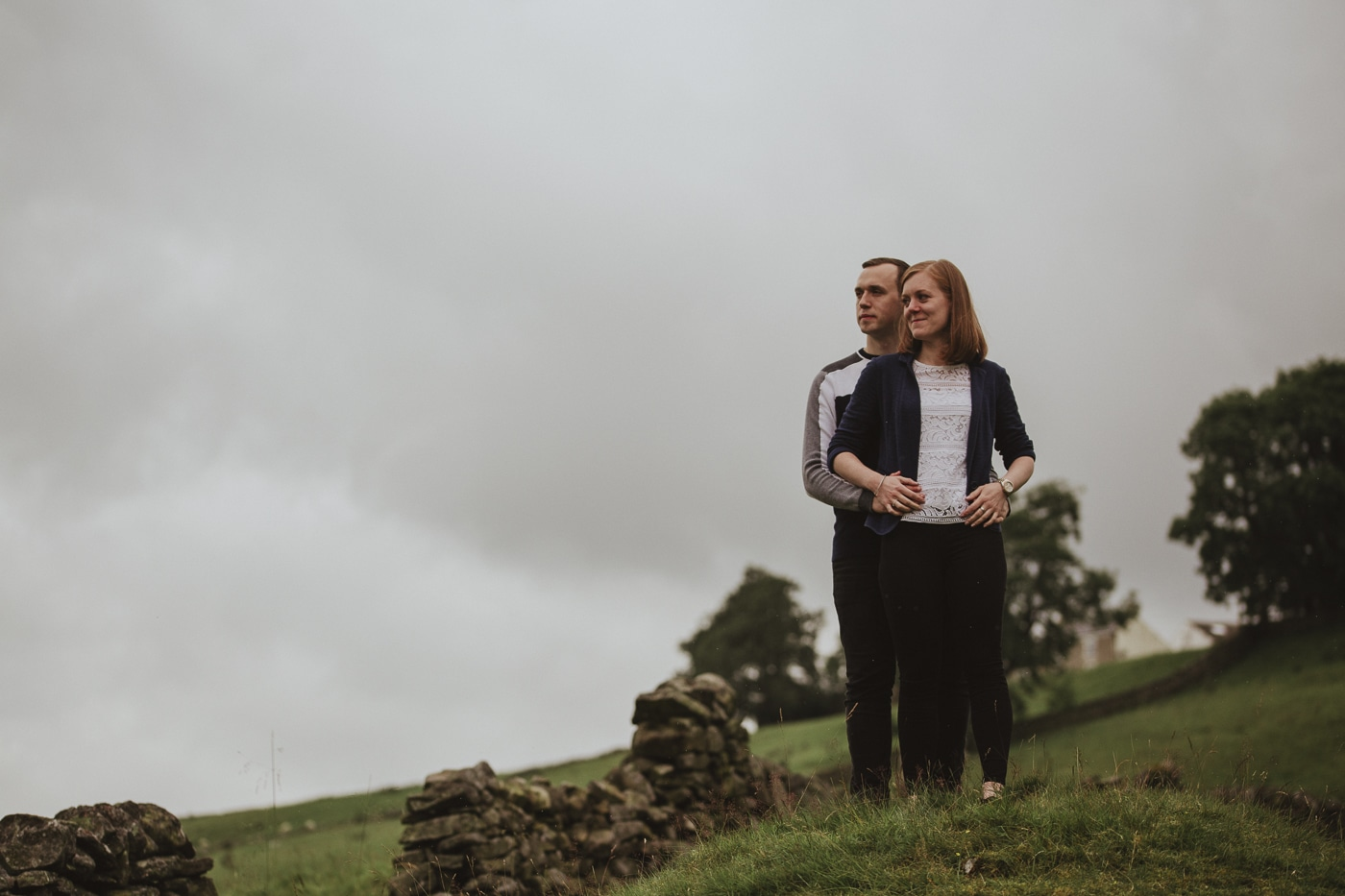 Boyfriend hold his girlfriend in a couple portrait session in the cumbrian landscape