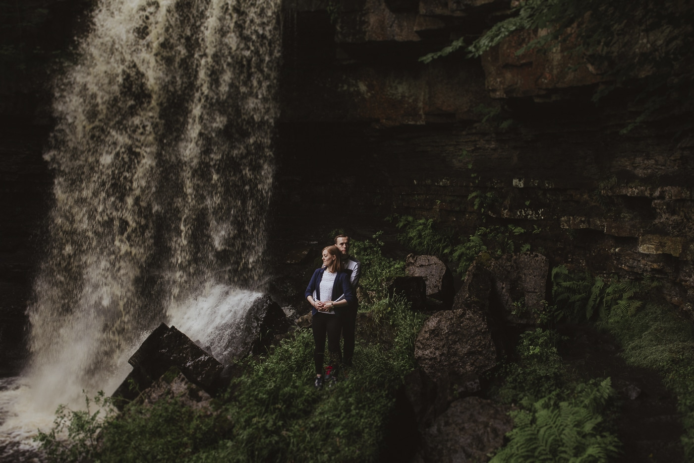 Couple standing next to a hidden waterfall couple portrait session