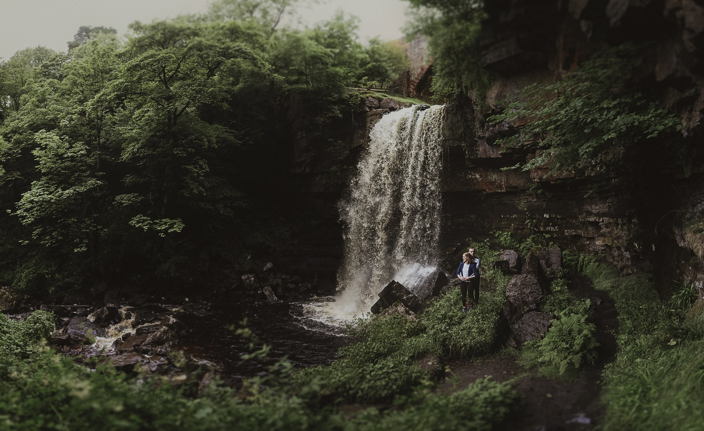Couple standing beside a hidden waterfall couple portrait session