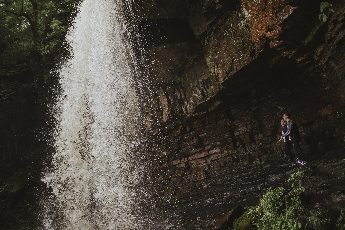 Couple standing in a hidden waterfall couple portrait session