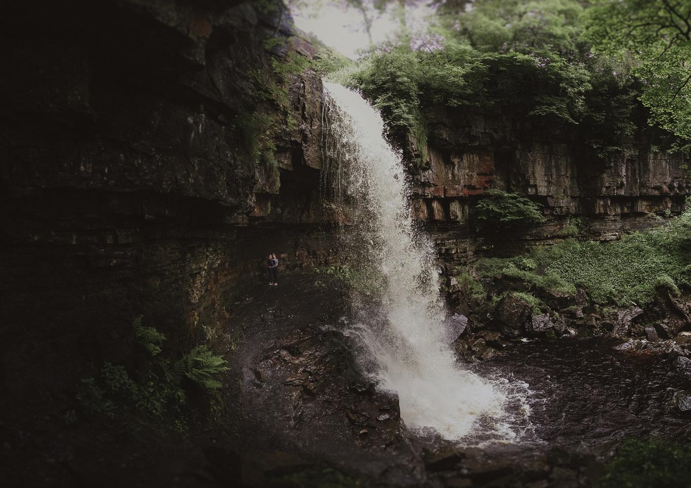 Hidden waterfall couple portrait session