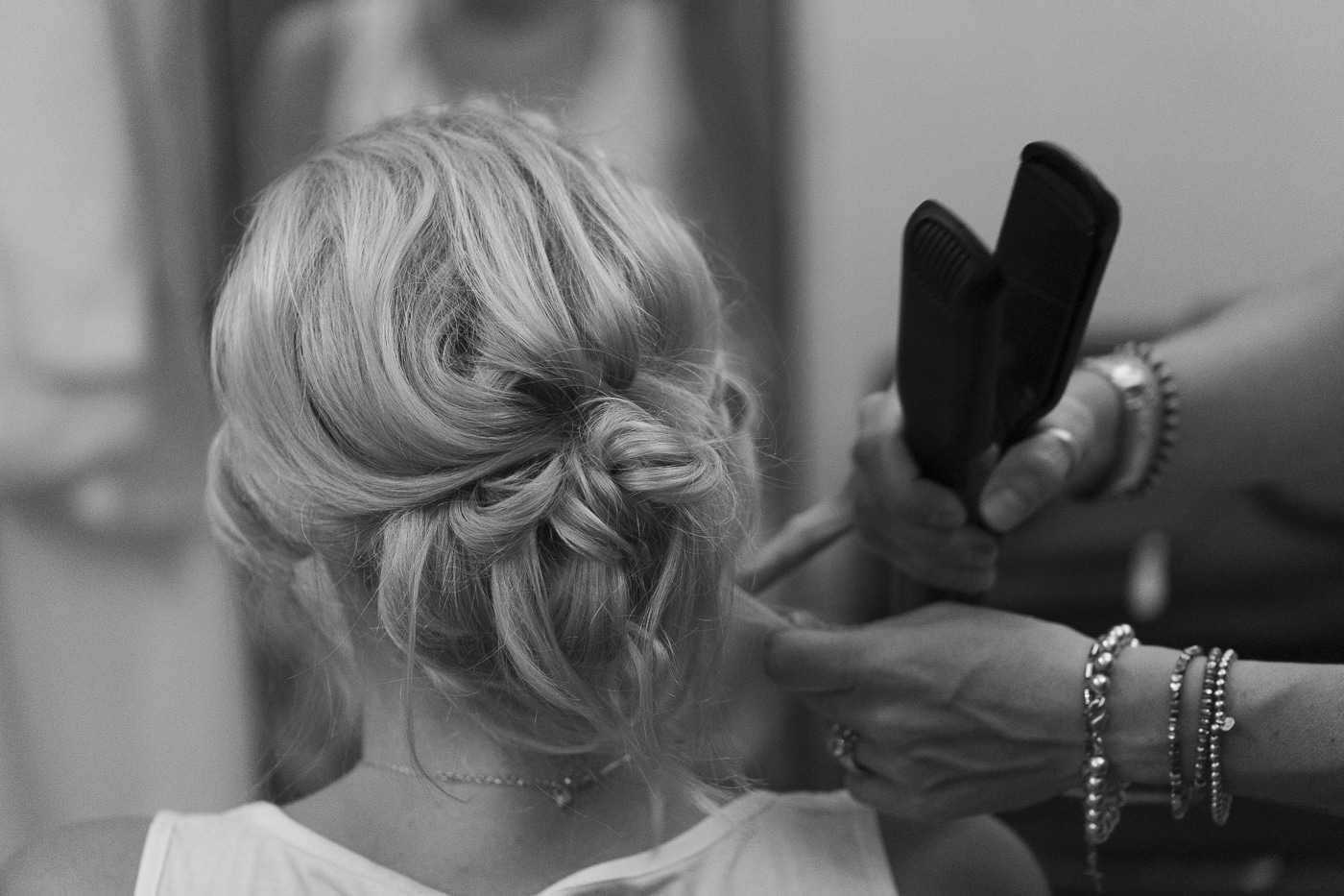 Bride having hair curled