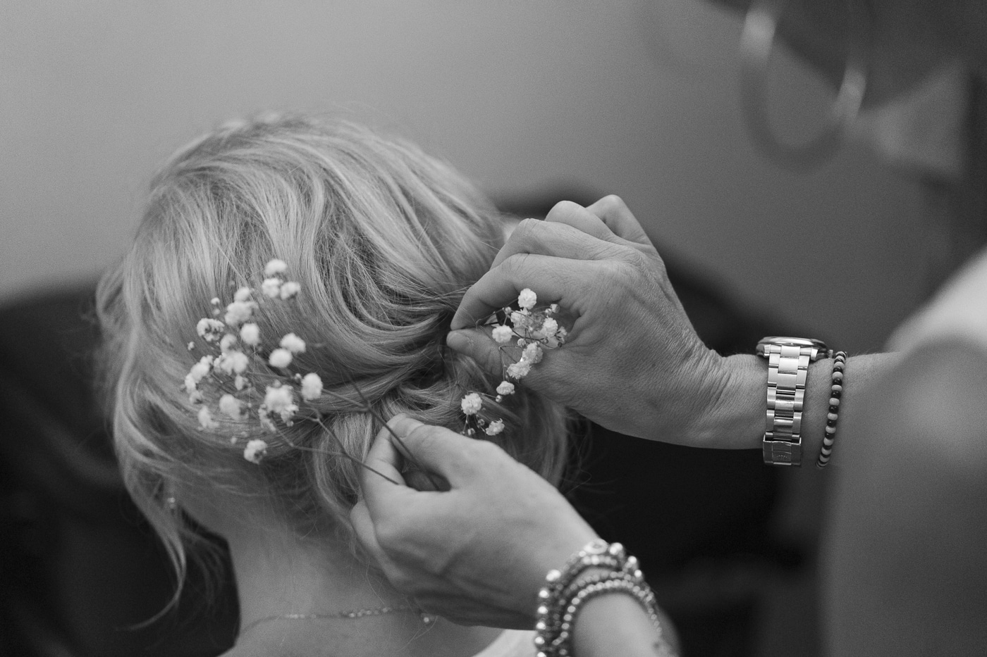 Bride having flowers put in her hair