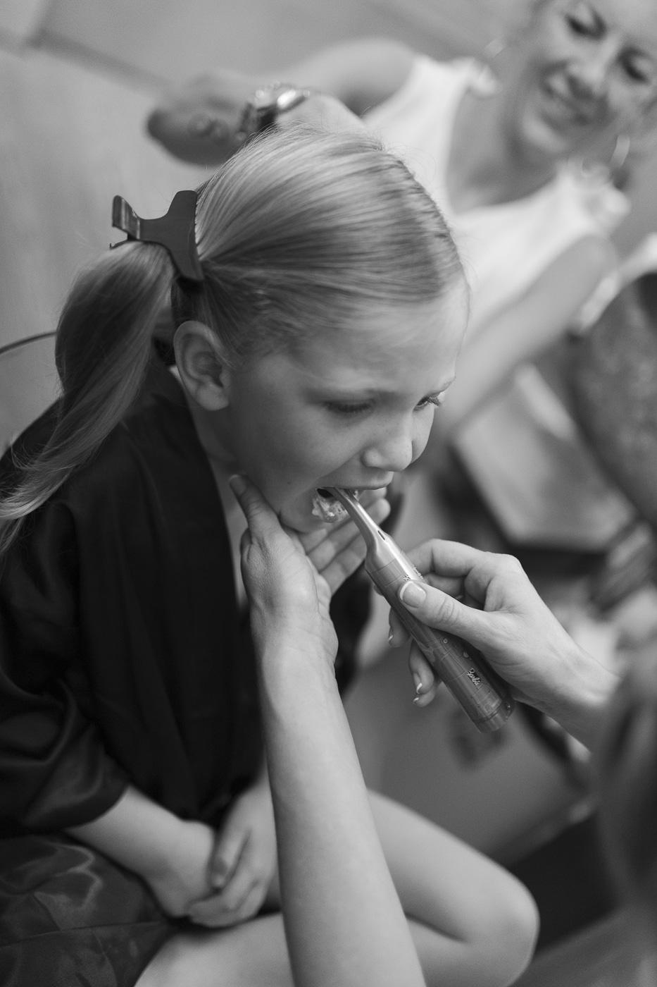 Brushing small girls teeth and doing hair
