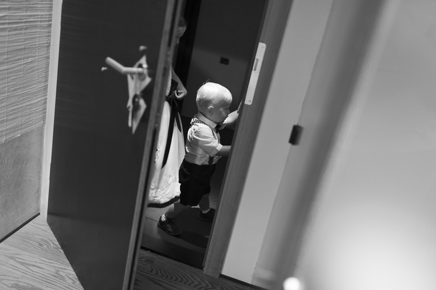 small boy and girl dressed up through hotel door