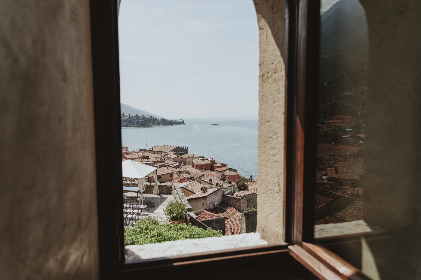 Looking out the window at lake garda in italy
