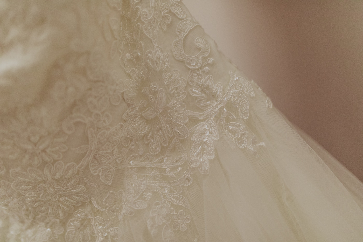 Close up of wedding dress with detailing and tulle