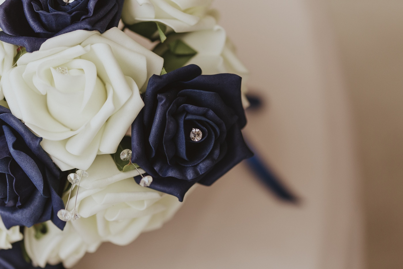 Black and white rose flowers with diamante gems in the middle and wrapped around the bridal bouquet by Joshua Wyborn