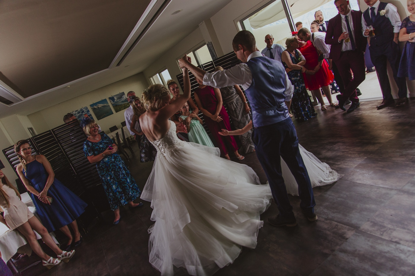 Bride and groom dancing and spinning letting white wedding dress flow by Joshua Wyborn