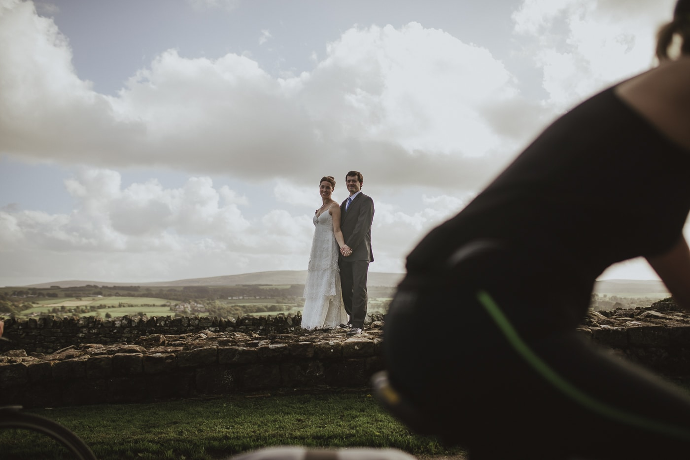 Couple standing on Hadrians Wall by Joshua Wyborn Photographic