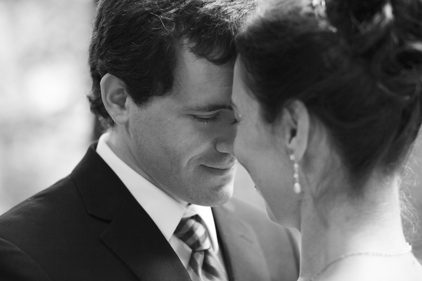 Bride and groom taking a moment together by Joshua Wyborn Photographic