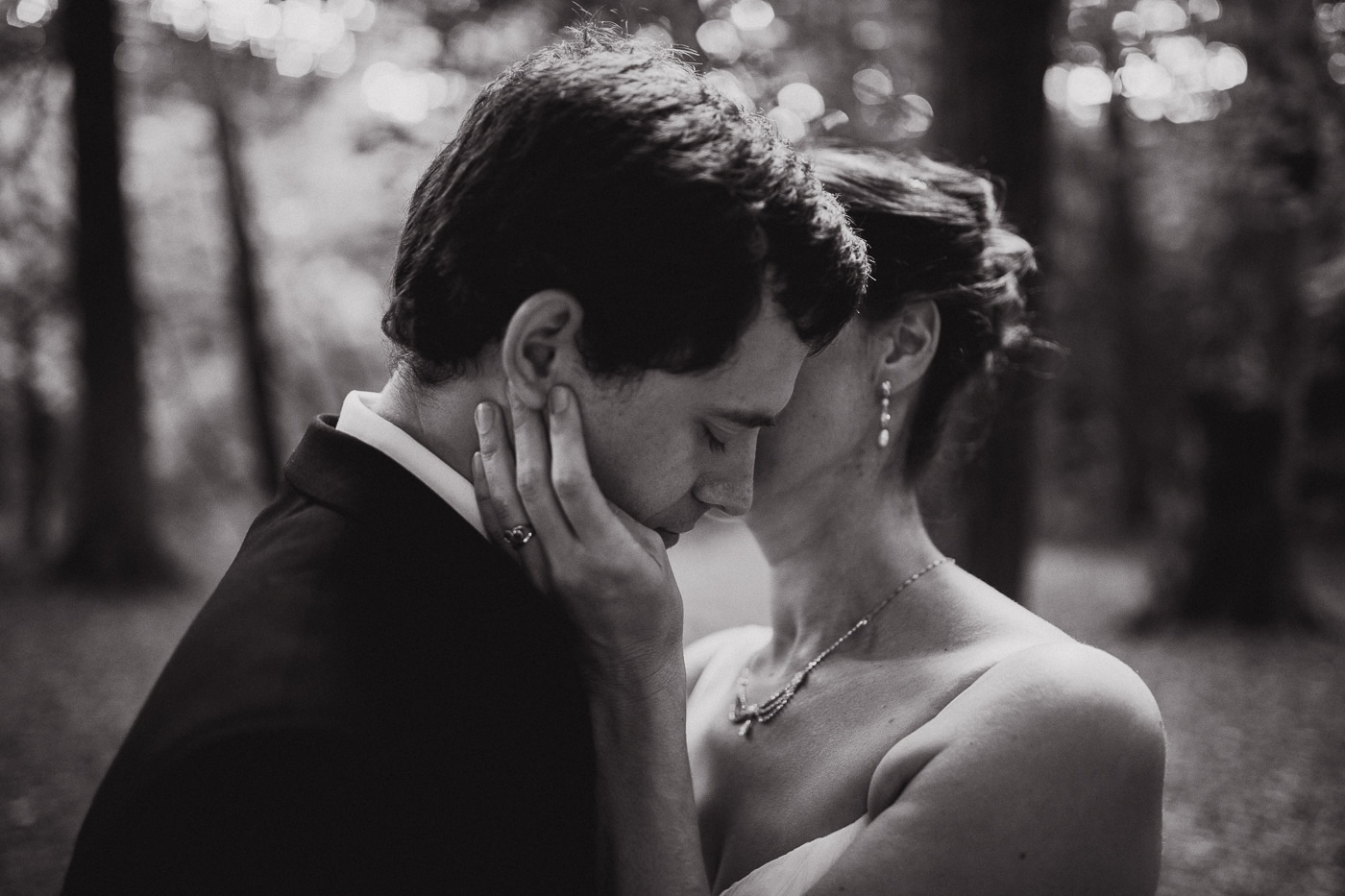 Bride embracing groom by Joshua Wyborn Photographic