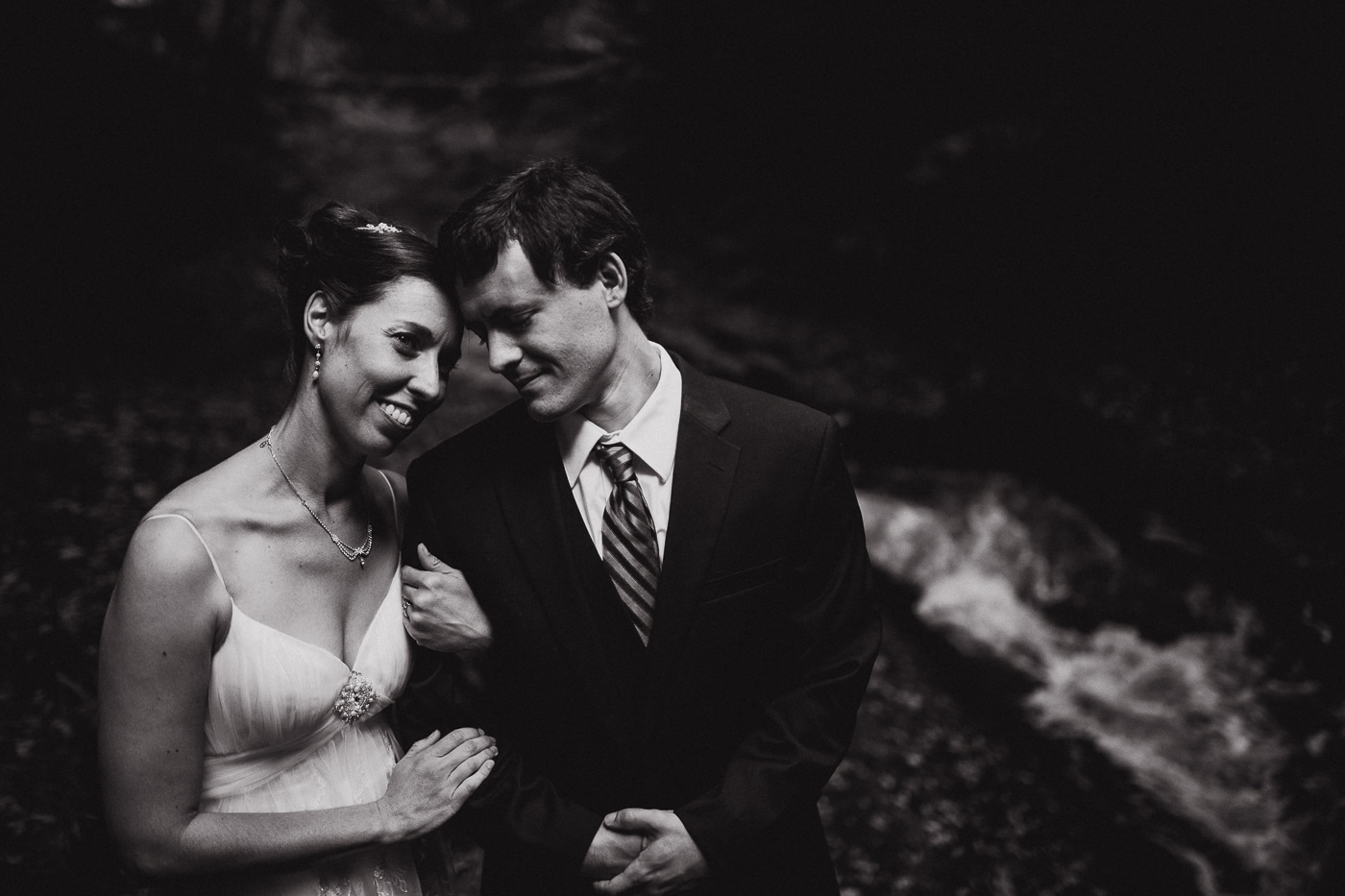 Getting close in the forest with a watefall for wedding by Joshua Wyborn photographic