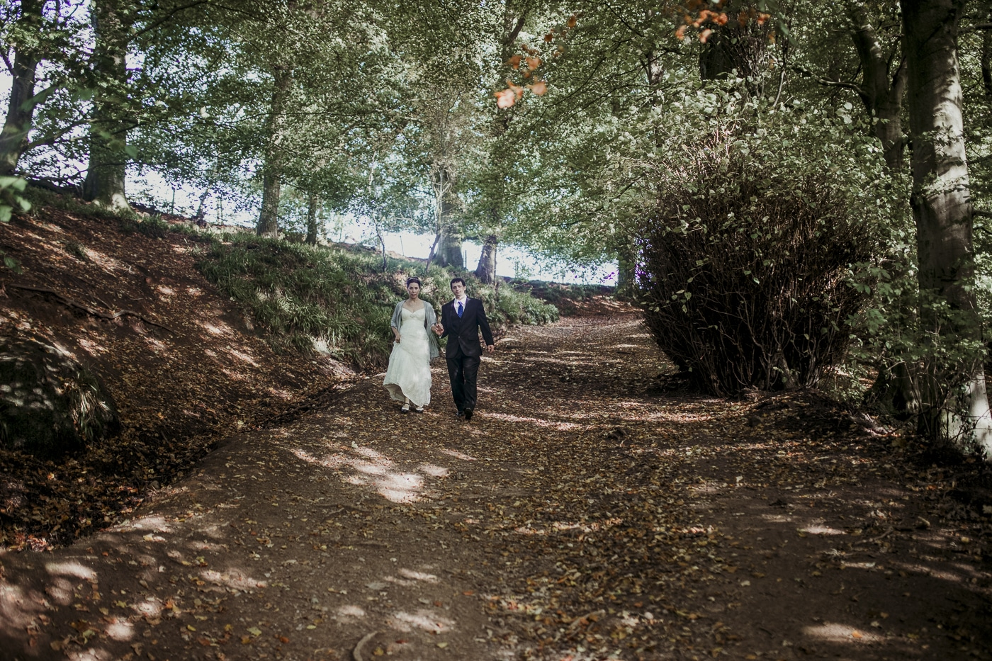 Walking through the woods for wedding by Joshua Wyborn photographic
