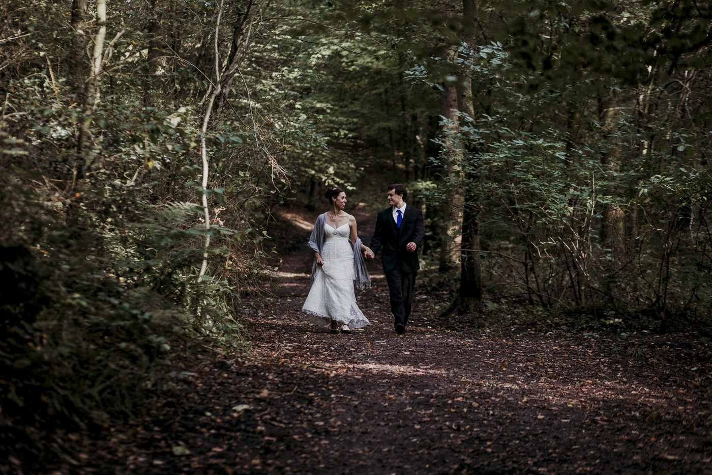 Walking through the woodland for elopement by Joshua Wyborn photographic