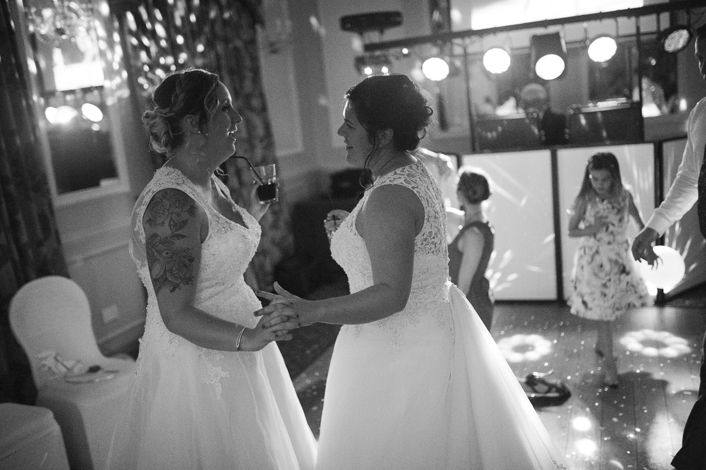 Brides dancing together for wedding photography by Joshua Wyborn