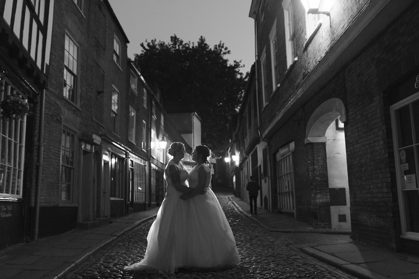 Backlit brides in the dark for wedding photography by Joshua Wyborn