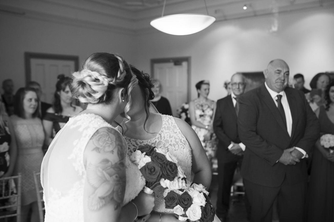 Brides first kiss after ceremony for wedding by Joshua Wyborn photography