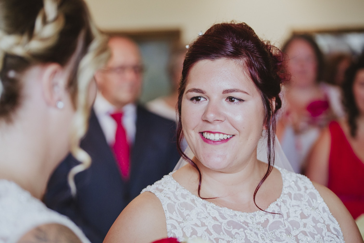 Smiling bride during vows for wedding by Joshua Wyborn photography