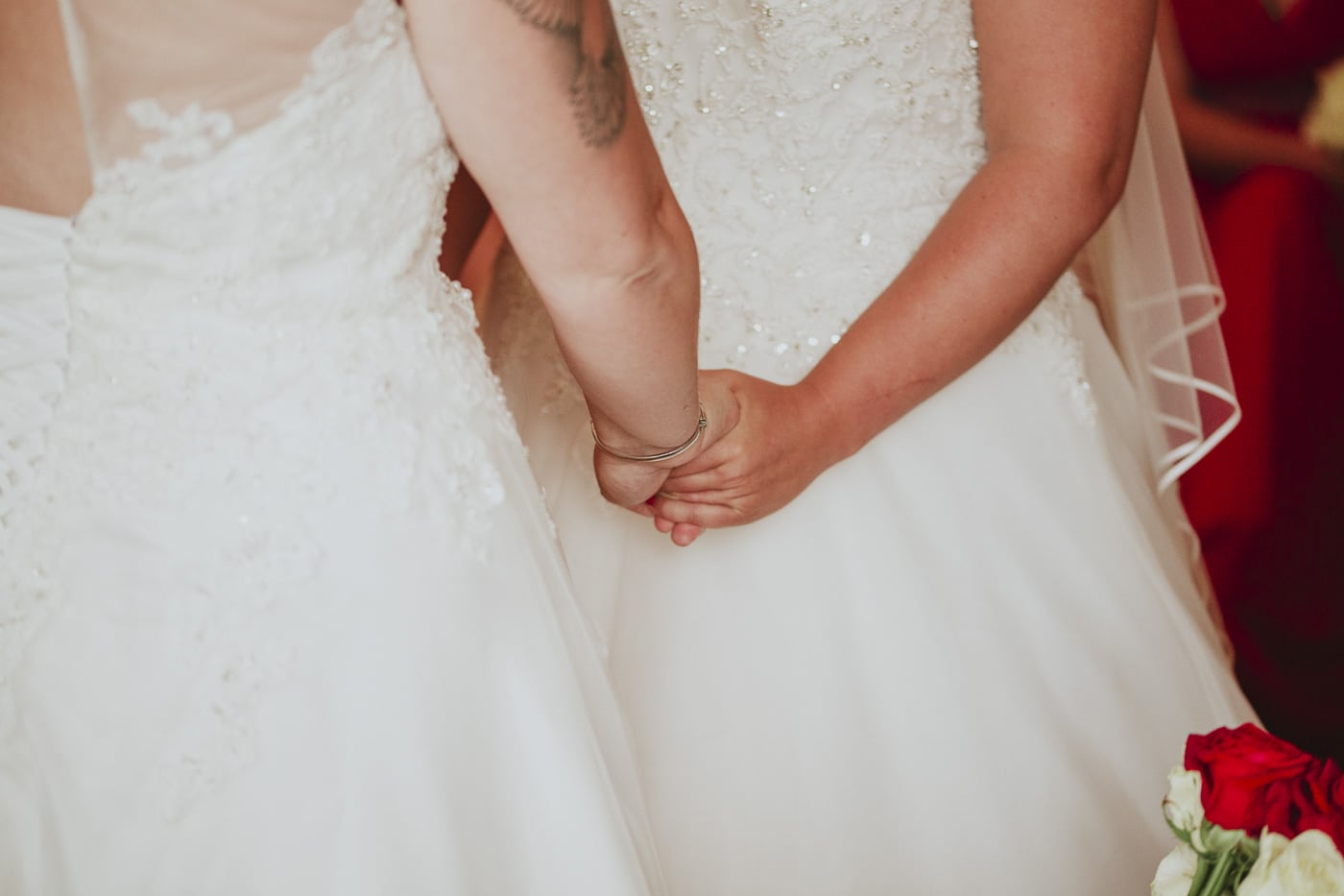 Holding hands after vows for wedding by Joshua Wyborn photography