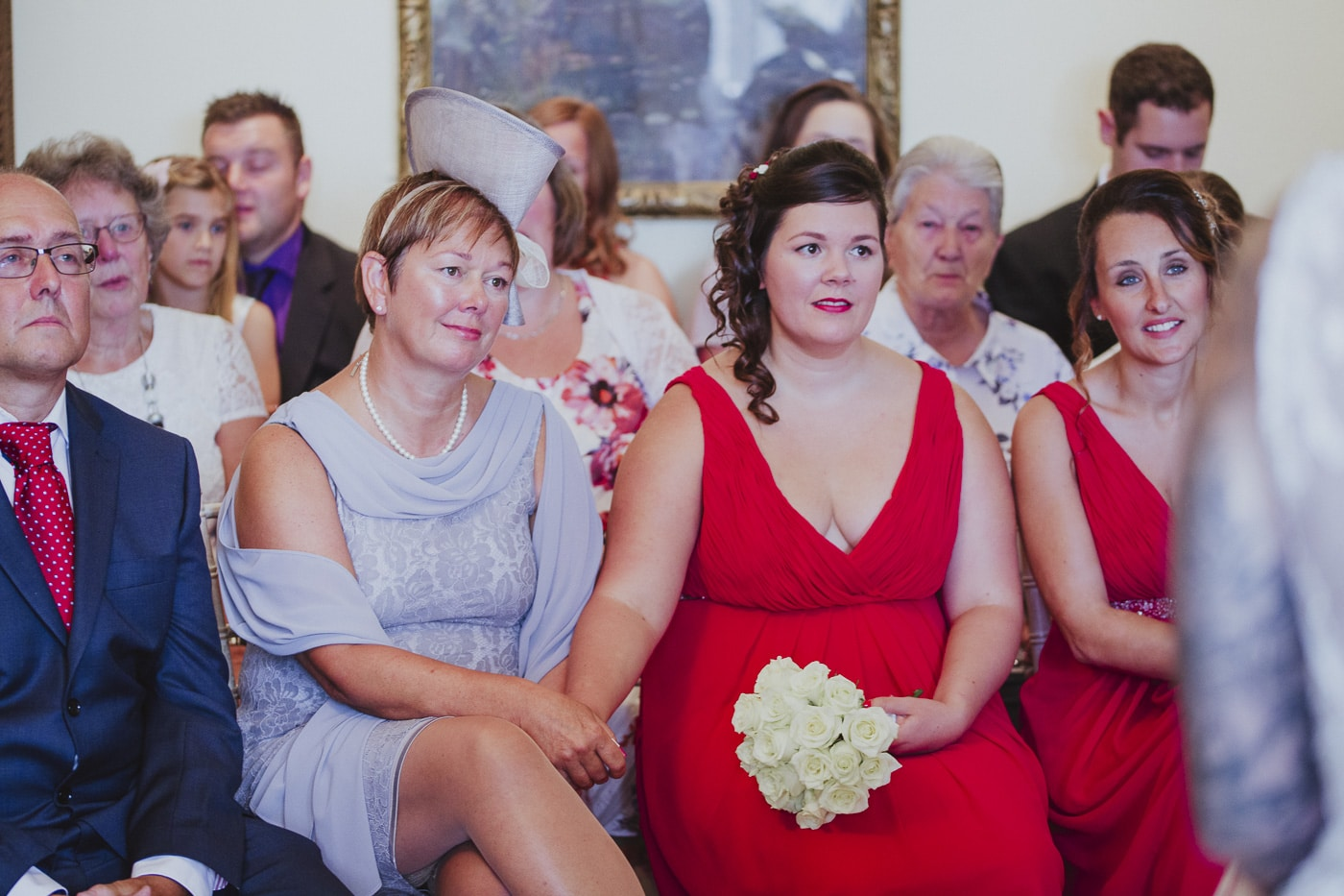 Bridesmaids dressed in red for wedding by Joshua Wyborn photography