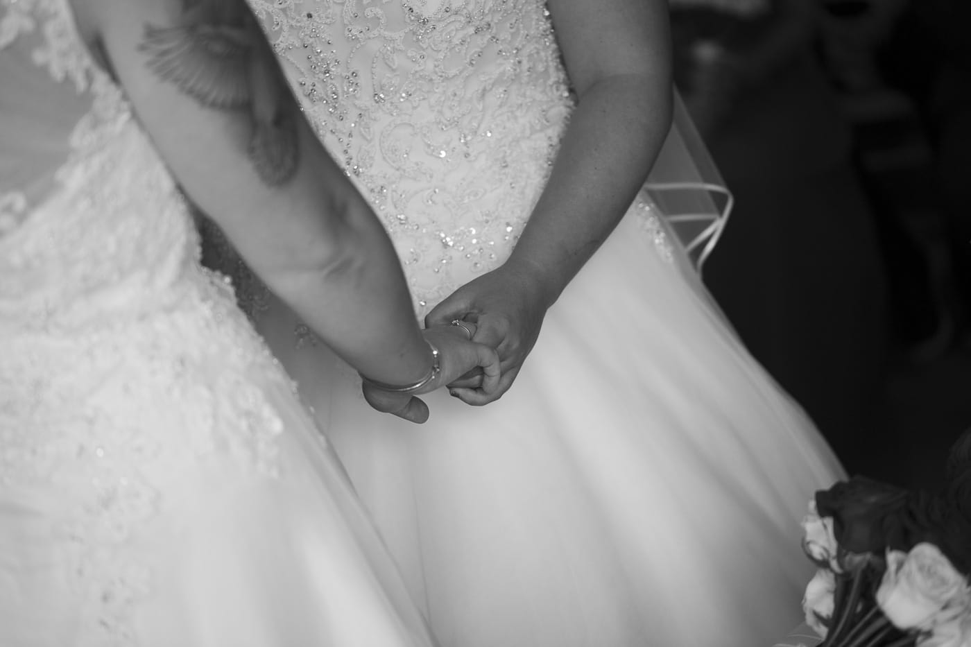 After giving of rings holding hands for wedding by Joshua Wyborn photography