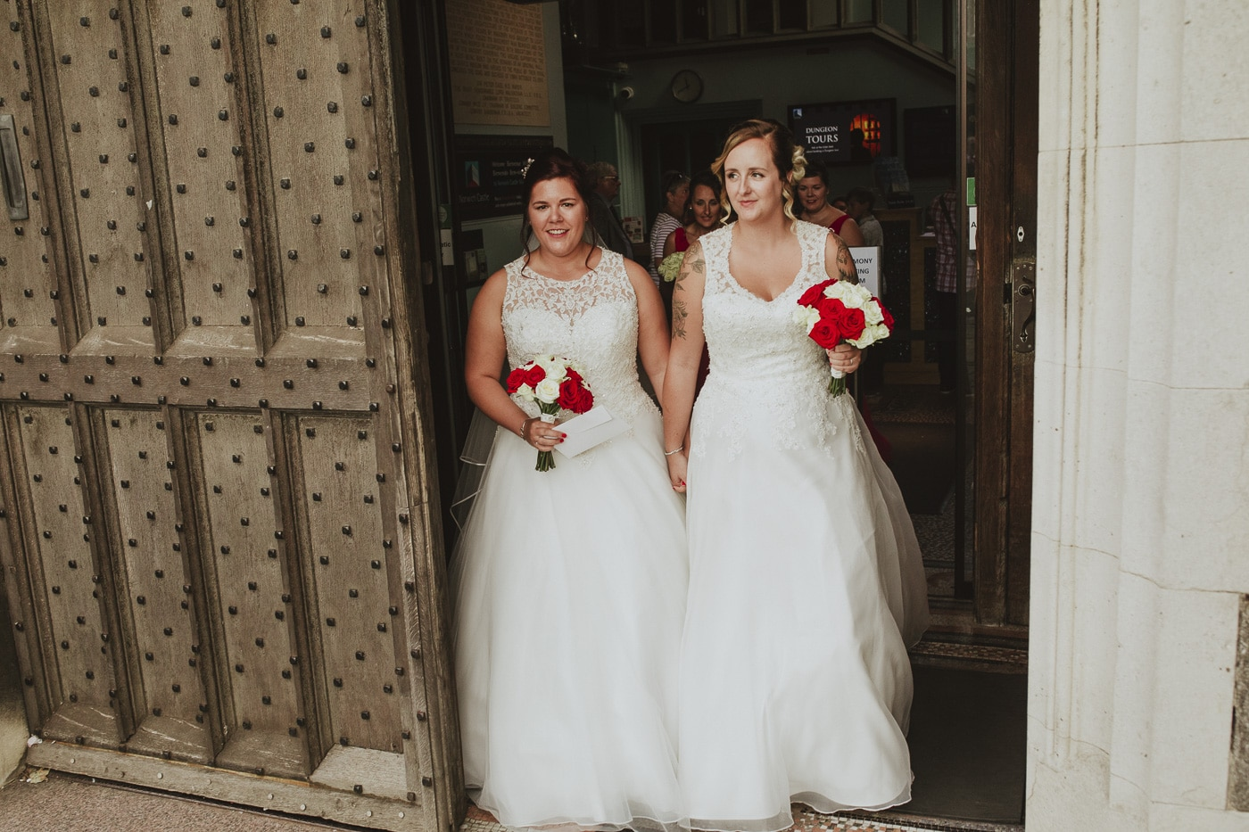 Brides walking out of ceremony for wedding by Joshua Wyborn photography