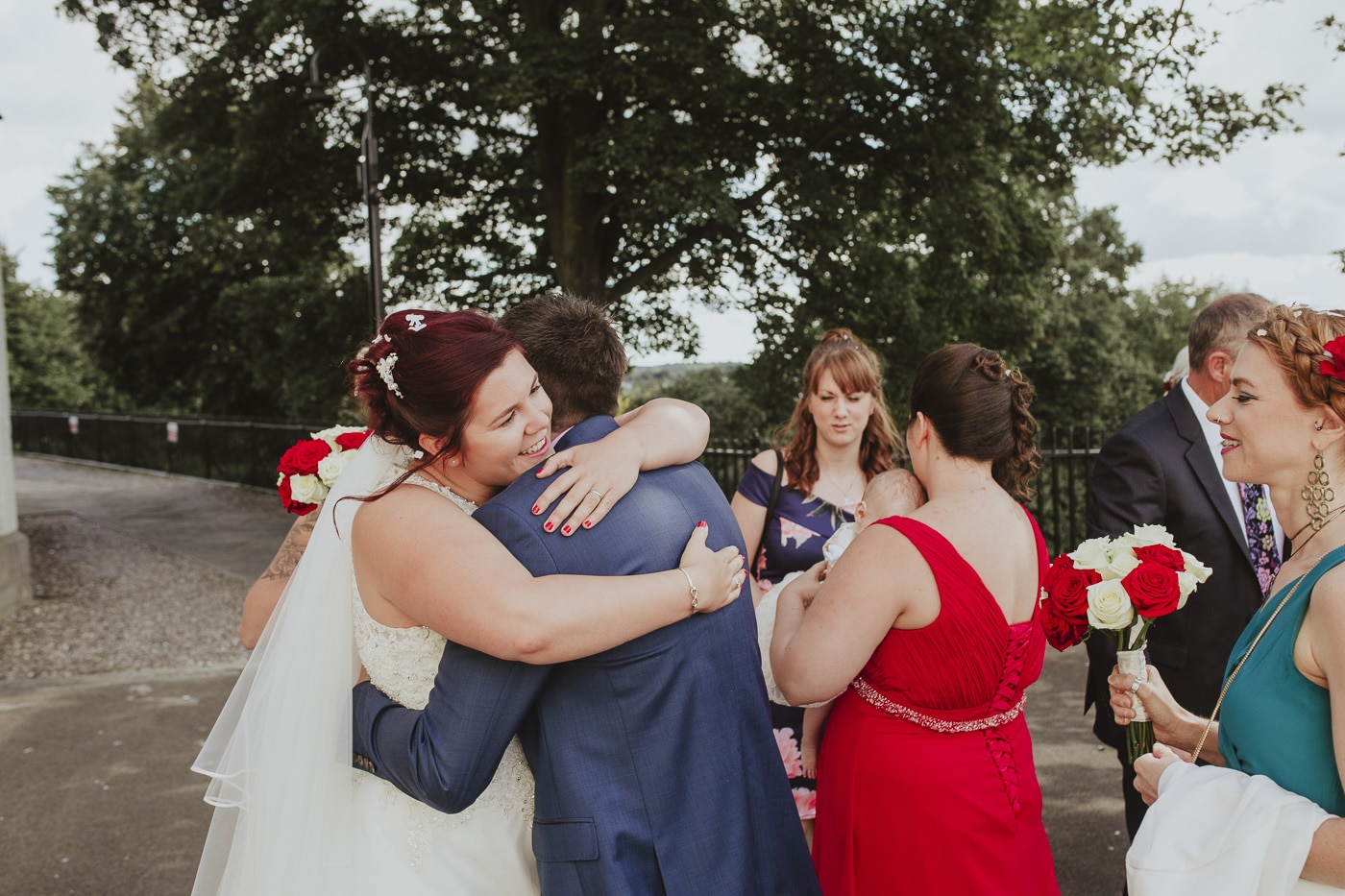 Bride hugging guests for wedding by Joshua Wyborn photography