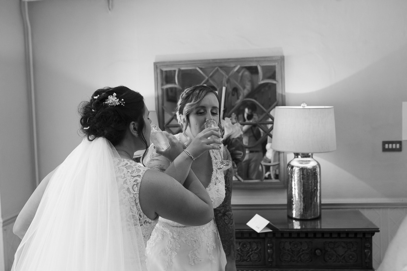 Brides drinking champagne for wedding by Joshua Wyborn photography