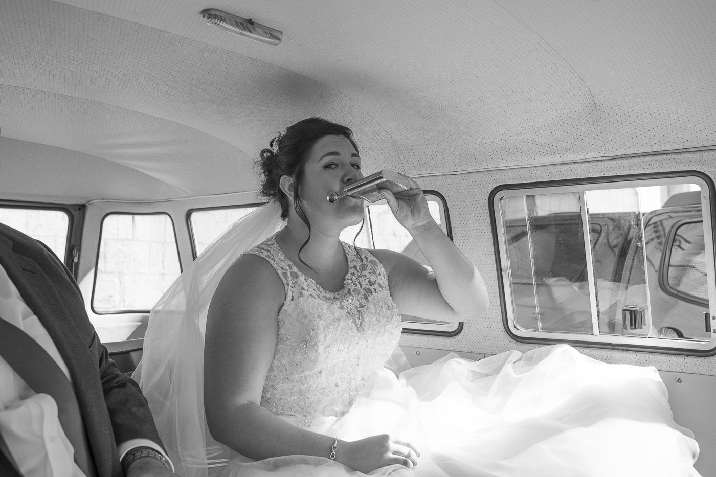 Bride drinking from hipflask for wedding by Joshua Wyborn