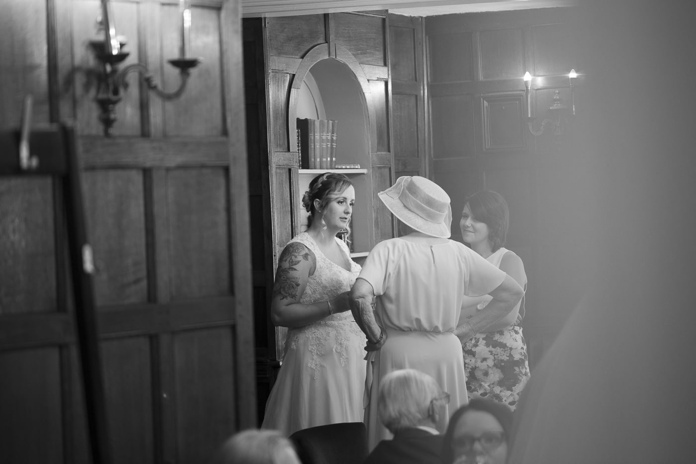Bride chatting to guests for wedding by Joshua Wyborn photography