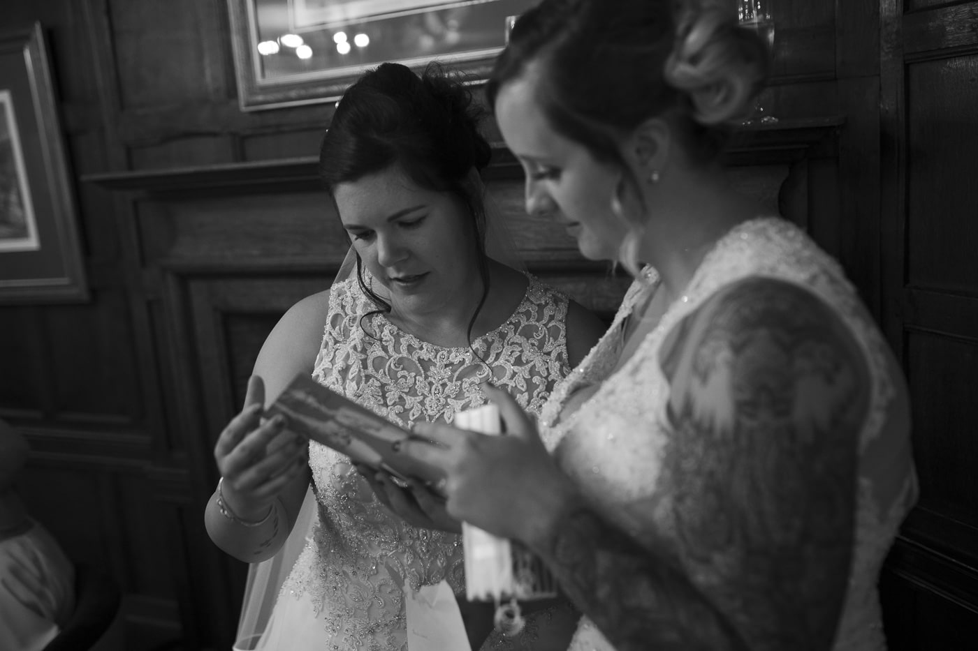 Brides reading card for wedding by Joshua Wyborn photography