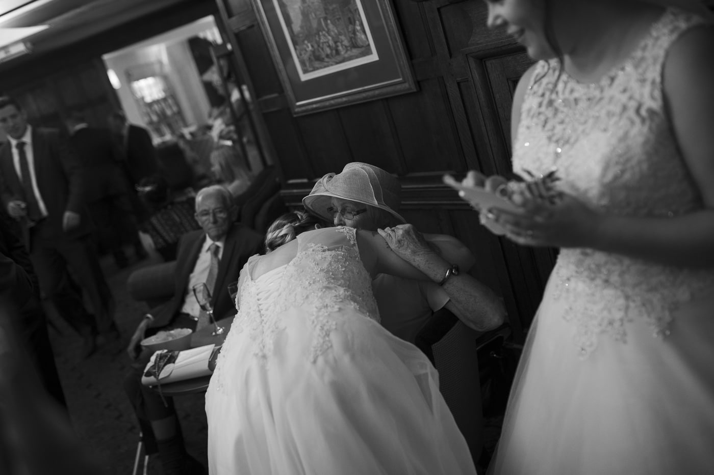 Bride hugging lady for wedding by Joshua Wyborn photography