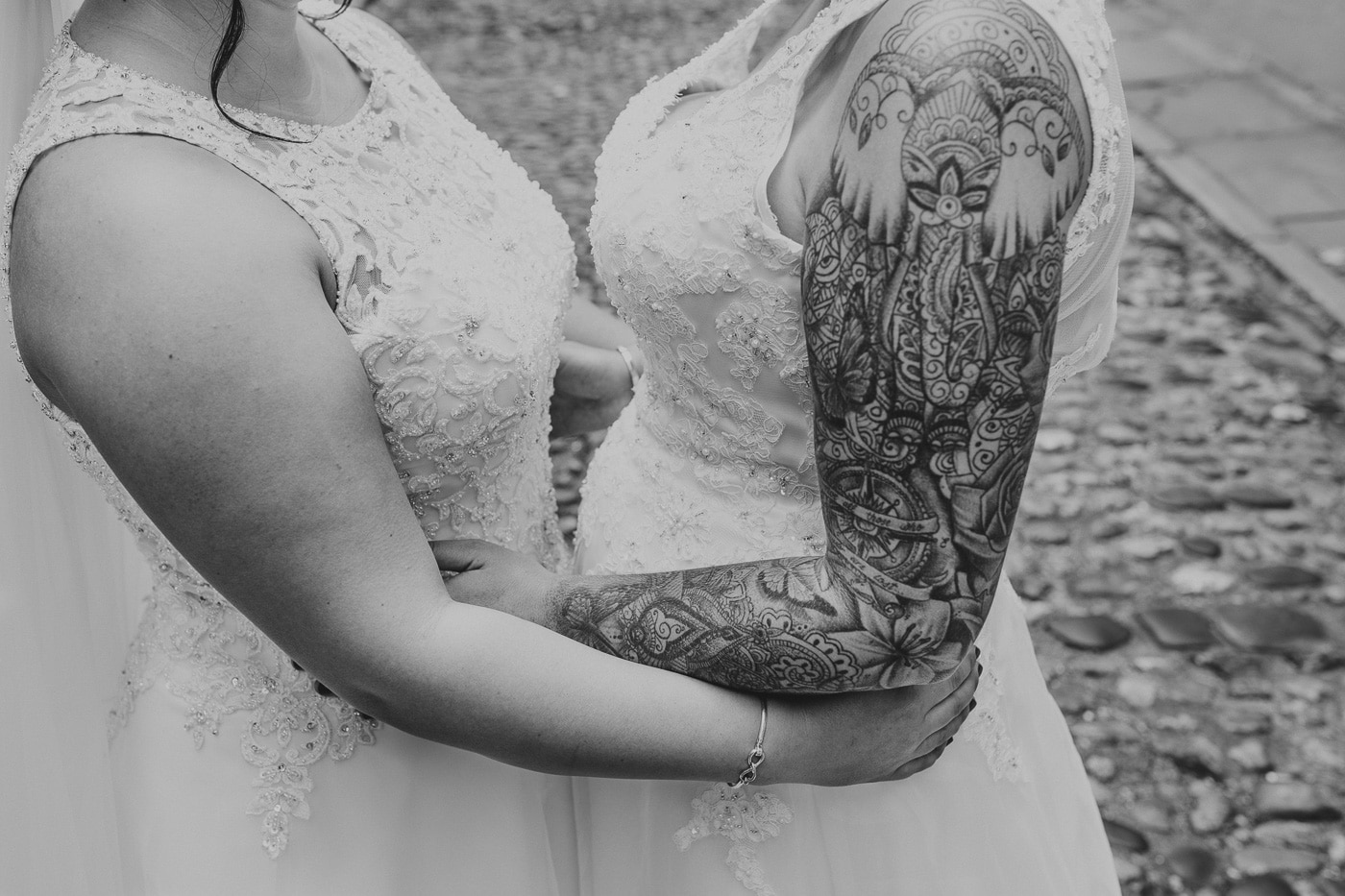Tattooed arm of bride for wedding by Joshua Wyborn photography