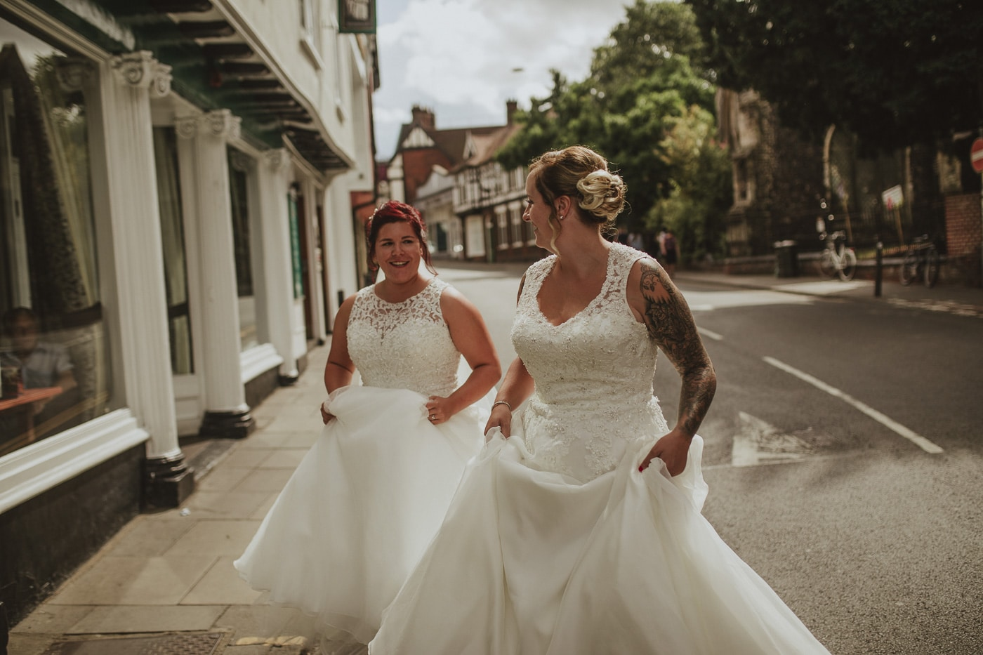 Brides walking down highstreet for wedding by Joshua Wyborn photography