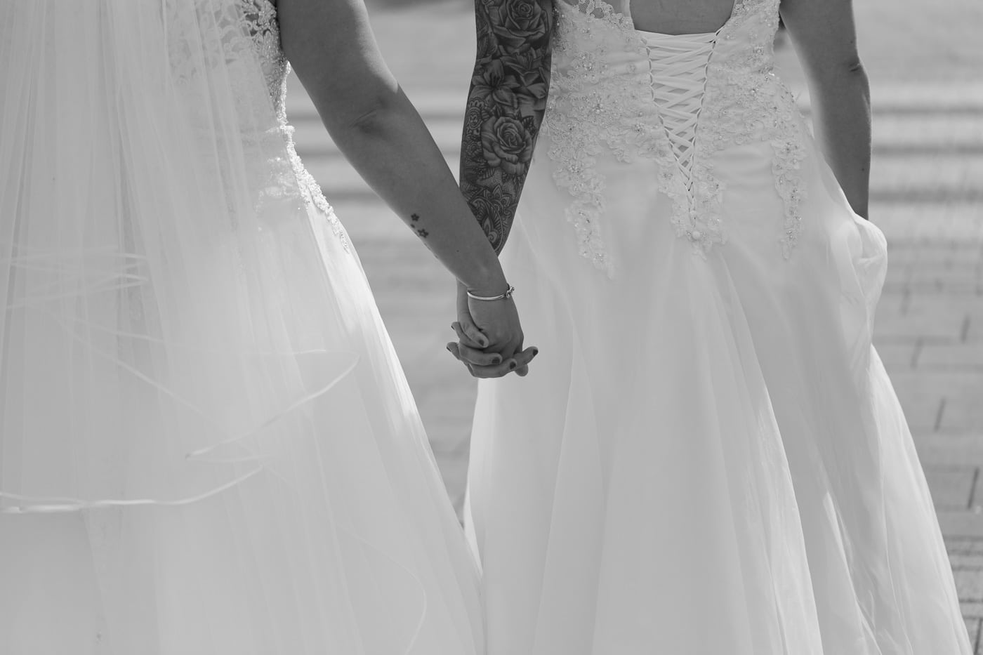 Brides holding hands for wedding by Joshua Wyborn photography