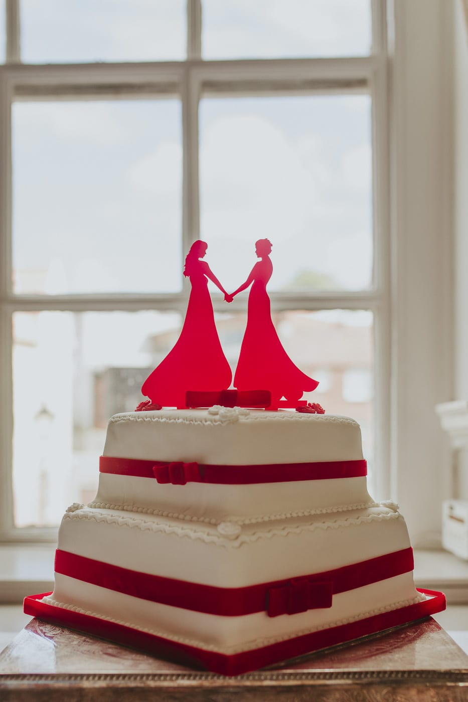 Red and white wedding cake for wedding by Joshua Wyborn photography