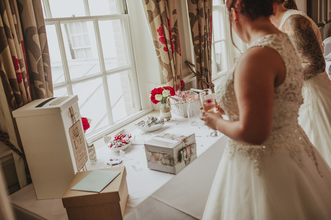 Brides looking over gift table for wedding by Joshua Wyborn photography