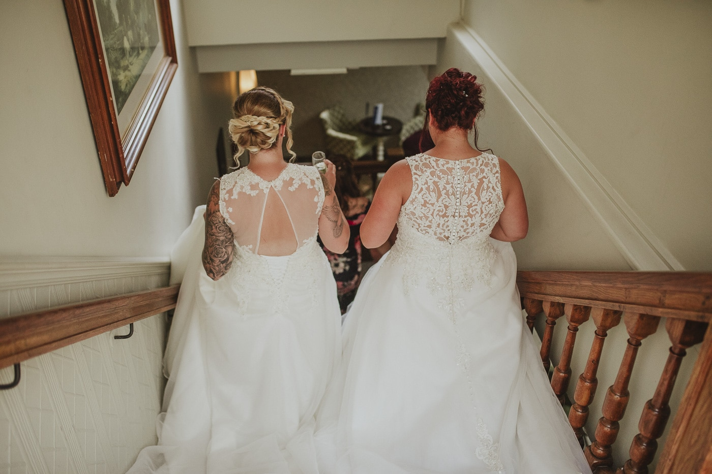 Brides walking down the stairs for wedding by Joshua Wyborn photography